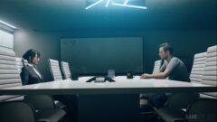 Shawn Ashmore sitting at a desk looking at a computer