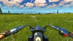a motorcycle parked in a grassy field
