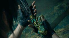 a hand holding a green dress