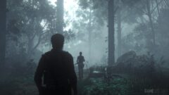 a man standing in front of a forest