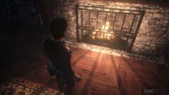 a boy sitting in a dark room