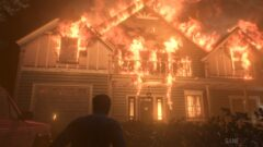 a man standing in front of a building on fire