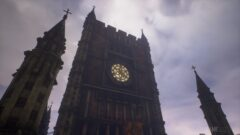 a large tall tower with a clock at the top of a building