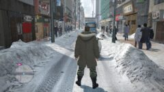 a person walking down a sidewalk covered in snow