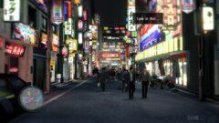 a group of people walking on Kabukichō, Tokyo street