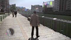 a man walking down a sidewalk in a city