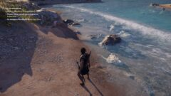 a man walking across a beach next to a body of water