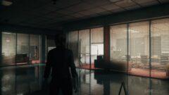 a man standing next to a window