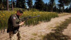 a young man holding a gun