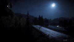 a bridge lit up at night
