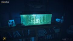 a flat screen tv sitting in a dark room