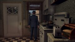 a man standing in a kitchen