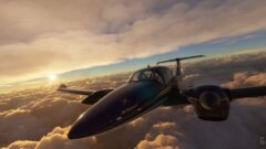 a close up of a propeller plane flying through a cloudy sky
