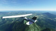 a plane flying high in the air with a mountain in the background