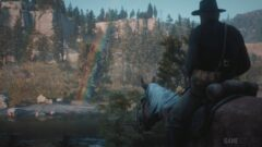 a man riding a horse in front of a mountain