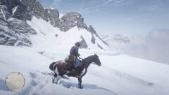 a man riding a horse in the snow