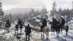 a group of people riding horses in the snow