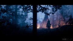 a man standing in a dark forest