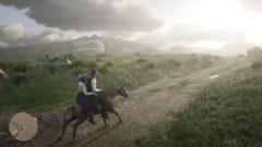 a man riding a horse on a dirt road